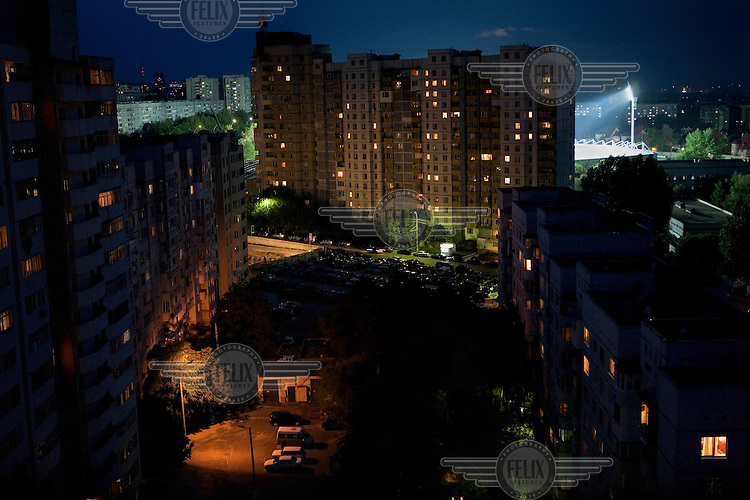 Apartment buildings and the floodlit National Stadium.