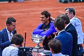 June 11th 2017, Roland Garros, paris, France; French Open tennis championship, mens singles final; Rafael Nadal versus Stan Wawrinka; The crowd stand during the ceremony to award the trophy to Rafael Nadal