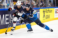 American Nick Schmaltz (L) being pushed onto the sideline by Finland's Lasse Kukkonen during the Ice Hockey World Championship quarter-final match between the US and Final in the Lanxess Arena in Cologne, Germany, 18 May 2017. Photo: Marius Becker/dpa /MediaPunch ***FOR USA ONLY***
