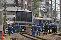 10th Anniversary File Photo: Rescue workers attempt to reach passengers still trapped inside a train that crashed into a building in Amagasaki, Japan on April 25, 2005. 107 people were killed in the accident, 562 were injured.<br /> <br /> The accident was Japan's most serious since a train accident in 1963 killed 162 people. (Photo by Duits.co/AFLO)