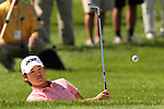 Yani Tseng chipped her ball out of the bunker and onto the 17th green at the 5th Annual Notah Begay III Foundation Challenge at Atunyote Golf Club in Vernon, New York on August 29, 2012