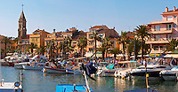 View of the harbour with fishing and leisure boats and sea front buildings Sanary Var Cote d'Azur France