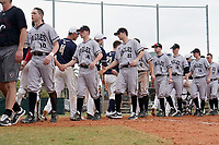 Edgewood Eagles shake hands with Bethel Wildcats after the second game of a double header on March 15, 2019 at Terry Park in Fort Myers, Florida.  Bethel defeated Edgewood 3-2.  Shown are Casey Willis (10), Will Mossa (18), Richie Coughlin (31), Ryan Fields (9), Ryan Cassady (5), Eric Nelson (19), Ryan Gale (14), and Dane Lamont (17).  (Mike Janes/Four Seam Images)