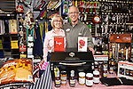 01/30/13--Ace Hardware owners, Gail and Terry Cain, have great gift ideas for Valentine's Day. A portable Traeger grill is great idea for Terry who likes to cook. And, gift cards, aprons, cupcake pans and wine bottle toppers for Gail..Photo by Jaime Valdez. ..