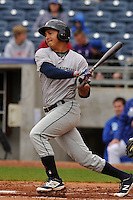 Mauricio Ramos (3) of the Northwest Arkansas Naturals follows through on his swing against the Tulsa Drillers at Oneok Field on May 2, 2016 in Tulsa, Oklahoma.  Northwest Arkansas won 9-6.  (Dennis Hubbard/Four Seam Images)