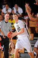 28 January 2012:  FIU center Gilles Dierickx (15) pulls down a rebound in the first half as the Western Kentucky University Hilltoppers defeated the FIU Golden Panthers, 61-51, at the U.S. Century Bank Arena in Miami, Florida.