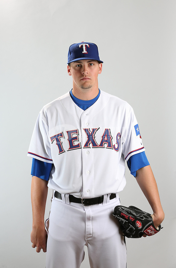 Feb. 20, 2013; Surprise, AZ, USA: Texas Rangers pitcher Coty Woods poses for a portrait during photo day at Surprise Stadium. Mandatory Credit: Mark J. Rebilas-