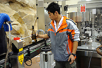 A young man working at winery of Treaty Port Vineyards in Penglai, Shandong province, China.<br /> 06 Nov 2010