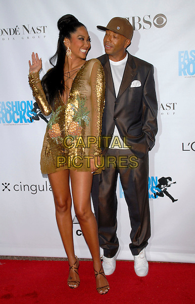 KIMORA LEE SIMMONS & RUSSELL SIMMONS.Conde Nast Media Group's Third Annual Fashion Rocks Concert at Radio City Music Hall, New York, NY, USA,.7 September 2006..full length gold sequined pineapple dress funny.Ref: ADM/PH.www.capitalpictures.com.sales@capitalpictures.com.©Paul Hawthorne/AdMedia/Capital Pictures. *** Local Caption ***