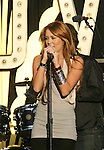 LOS ANGELES, CA. - April 28: Actress/singer Miley Cyrus performs at the World Wish Day Celebration With Miley Cyrus at The Grove on April 28, 2010 in Los Angeles, California.