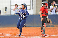 11 February 2012:  FIU's Ashley McClain (2) scores as the University of Louisville Cardinals defeated the FIU Golden Panthers, 4-2, as part of the COMBAT Classic at the FIU Softball Complex in Miami, Florida.