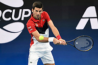 11th January 2020; Sydney Olympic Park Tennis Centre, Sydney, New South Wales, Australia; ATP Cup Australia, Sydney, Day 9; Serbia versus Russia;  Novak Djokovic versus Daniil Medvedev; Novak Djokovic of Serbia hits a backhand to Daniil Medvedev of Russia - Editorial Use