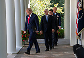 "United States President Donald J. Trump, followed by US Vice President Mike Pence, US Secretary of Defense Dr. Mark T. Esper and General John W. ""Jay"" Raymond, Commander, Air Force Space Command, walk on the colonnade to announce the establishment the US Space Command in the Rose Garden of the White House in Washington, DC on Thursday, August 29, 2019.  The Space Command will be the lead military agency for the planning and execution of space operations and will be a step towards establishing a Space Force as a new military service.<br /> Credit: Ron Sachs / Pool via CNP"