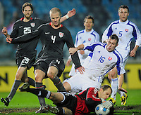 John Mucha saves the ball with Jan Durica (16) against Michael Bradley (4). Slovakia defeated the US Men's National Team 1-0 at the Tehelne Pole in Bratislava, Slovakia on November 14th, 2009.