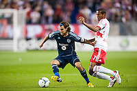 Graham Zusi (8) of Sporting Kansas City is marked by Roy Miller (7) of the New York Red Bulls during a Major League Soccer (MLS) match at Red Bull Arena in Harrison, NJ, on April 17, 2013.