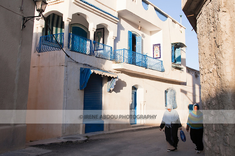 Women in arabic dress stroll the streets of Le Kef, the unofficial capital of Western Tunisia.