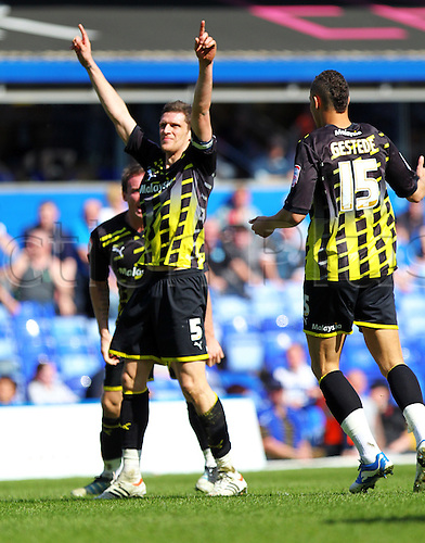 25.03.2012 Birmingham, England. Goalscorer Cardiff English Defender Mark Hudson celebrates after his goal during the Football League Championship Match between Birmingham City and Cardiff City, played at St Andrews. ..