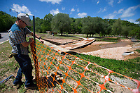 NWA Democrat-Gazette/JASON IVESTER<br /> Nathan Hudgens (cq), Lake Atalanta park manager, puts up netting Monday, May 1, 2017, at the park in Rogers. The park is closed until further notice following damage from weekend storms.