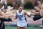 Emory Gaeng (5) of the High Point Panthers high fives her teammates during player introductions prior to the match against the North Carolina Tar Heels at Vert Track, Soccer & Lacrosse Stadium on February 16, 2018 in High Point, North Carolina.  The Tar Heels defeated the Panthers 14-10.  (Brian Westerholt/Sports On Film)