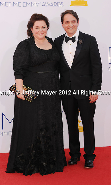 LOS ANGELES, CA - SEPTEMBER 23: Melissa McCarthy and Ben Falcone arrive at the 64th Primetime Emmy Awards at Nokia Theatre L.A. Live on September 23, 2012 in Los Angeles, California.