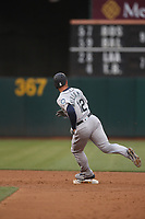 OAKLAND, CA - JUNE 14:  Mac Williamson #12 of the Seattle Mariners runs the bases against the Oakland Athletics during the game at the Oakland Coliseum on Friday, June 14, 2019 in Oakland, California. (Photo by Brad Mangin)