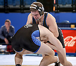 BROOKINGS, SD - JANUARY 11:  Brance Simms from South Dakota State University controls Chad McCannon from Dakota Wesleyan in their 133 pound match Sunday afternoon at Frost Arena in Brookings. (Photo by Dave Eggen/Inertia)