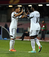 Thursday 27 February 2014<br /> Pictured L-R: Jonathan de Guzman and team mate Wilfried Bony of Swansea celebrating the former's equaliser making the score 1-1.<br /> Re: UEFA Europa League, SSC Napoli v Swansea City FC at Stadio San Paolo, Naples, Italy.