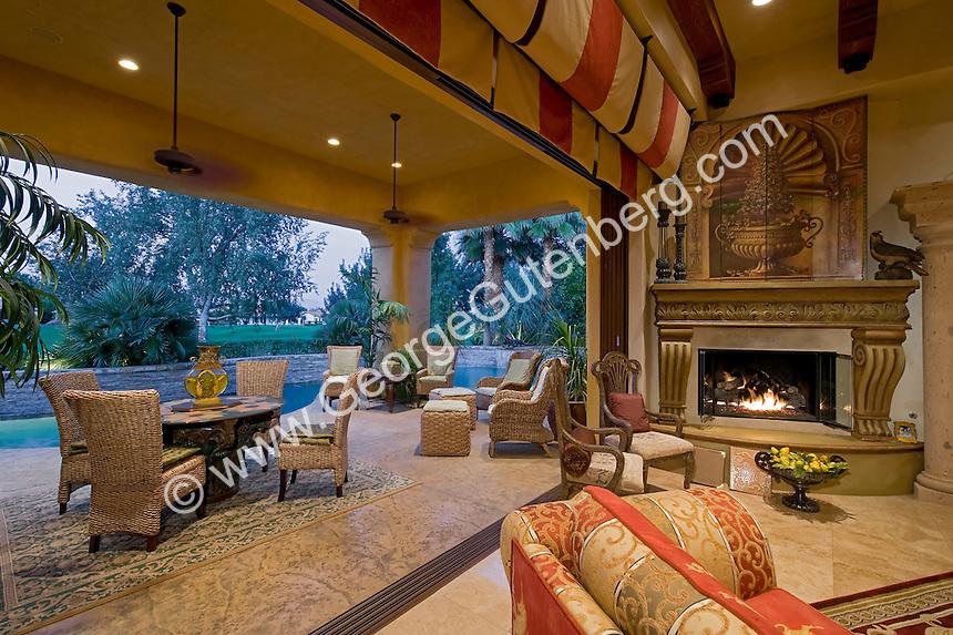Luxurious home overlooks out doors living area through open pocket doors