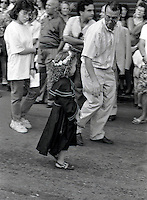 Palermo, feast of Saint Rosalia:little girl dressed like Rosalia during procession (1990).<br />