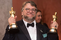 Guillermo del Toro poses with both the Oscar&reg; for best picture and achievement in directing for work on &ldquo;The Shape of Water&rdquo; at the Governors Ball following the live ABC Telecast of The 90th Oscars&reg; at the Dolby&reg; Theatre in Hollywood, CA on Sunday, March 4, 2018.<br /> *Editorial Use Only*<br /> CAP/PLF/AMPAS<br /> Supplied by Capital Pictures