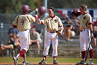Boston College Eagles Jake Palomaki (center) and Michael Strem (right) greet Joe Cronin (4) after a home run during a game against the Central Michigan Chippewas on March 8, 2016 at North Charlotte Regional Park in Port Charlotte, Florida.  Boston College defeated Central Michigan 9-3.  (Mike Janes/Four Seam Images)