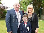 Ryan Delaney from St. Joseph's School who received his first holy communion in St. Joseph's church Mell with grandparents Michael and Paula Delaney. Photo:Colin Bell/pressphotos.ie