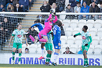 Alex Palmer of Plymouth Argyle collects the corner under pressure from Theo Robinson of Colchester United and Tom Eastman of Colchester United during Colchester United vs Plymouth Argyle, Sky Bet EFL League 2 Football at the JobServe Community Stadium on 8th February 2020