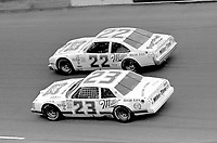 Bobby Allison (22) and Davey Allison race side by side off turn four in their Sportsman cars  at Daytona in February 1984.(Photo by Brian Cleary)
