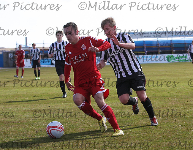 Stephen O'Neill  shields the ball from Jon Scullion in the Aberdeen v St Mirren Clydesdale Bank Scottish Premier League Under 20 match played at Balmoor Stadium, Peterhead on 19.4.13.