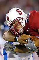 Matt Leonard makes an interception (2nd) during Stanford's 63-26 win over San Jose State on September 14, 2002 at Stanford Stadium.<br />
