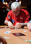 Team Pokerstars Pro Tom McEvoy stacks his chips after doubling up..