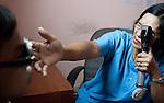 Seng Samarun, 12 has his eyes examined by Nurse Channy at Angkor Children's Hospital, Siem Reap, Cambodia.