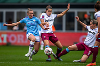 17th November 2019; Academy Stadium, Manchester, Lancashire, England; The FA's Women's Super League, Manchester City Women versus West Ham United Women; Georgia Stanway of Manchester City Women and Gilly Flaherty of West Ham Women go for the loose ball - Editorial Use