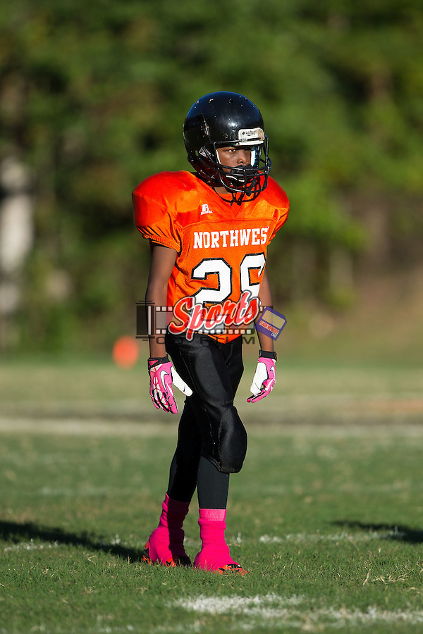 DeAvion Pless (28) of the Northwest Cabarrus Titans on defense against the Winkler Wolves in 7th grade football action at Trojan Stadium October 7, 2014, in Concord, North Carolina.  The Titans defeated the Wolves 58-30.  (Brian Westerholt/Sports On Film)