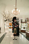 The bagpiper announces the noon hour at the famous Montreal clothing store La Maison Ogilvy