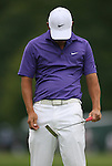 7 September 2008:    Anthony Kim hangs his head after making a bad putt during the fourth and final round of play at the BMW Golf Championship at Bellerive Country Club in Town & Country, Missouri, a suburb of St. Louis, Missouri on Sunday September 7, 2008. The BMW Championship is the third event of the PGA's  Fed Ex Cup Tour.