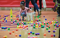 NWA Democrat-Gazette/J.T. WAMPLER Skye Cox, 4,  collects treat-filled eggs Sunday April 14, 2019 during Easter at the Club at the Donald W. Reynolds Boys and Girls Club in Fayetteville. Around 16 thousand eggs were filled for the event. Skye came to the event with her mom, Rosanna Trevino of Fayetteville.