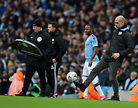 26th January 2020; Etihad Stadium, Manchester, Lancashire, England; English FA Cup Football, Manchester City versus Fulham; Manchester City manager Pep Guardiola collects the ball as it bounces into the technical area