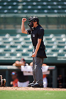 Umpire Emma Charlesworth-Seiler strike call during an Instructional League game between the Atlanta Braves and Baltimore Orioles on September 25, 2017 at the Ed Smith Stadium in Sarasota, Florida.  (Mike Janes/Four Seam Images)