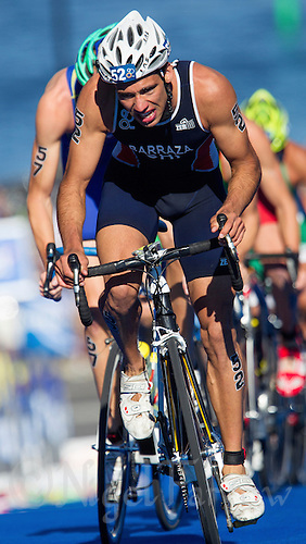 25 AUG 2013 - STOCKHOLM, SWE - Felipe Barraza (CHI) of Chile climbs a hill during the bike at the men's ITU 2013 World Triathlon Series round in Gamla Stan, Stockholm, Sweden (PHOTO COPYRIGHT © 2013 NIGEL FARROW, ALL RIGHTS RESERVED)