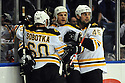 Jan 15, 2009; Uniondale, NY, USA; Boston Bruins center Martin St. Pierre (47) celebrates with teammates after scoring a goal against the New York Islanders at the Nassau Coliseum. Mandatory Credit: Tomasso DeRosa/SportPics