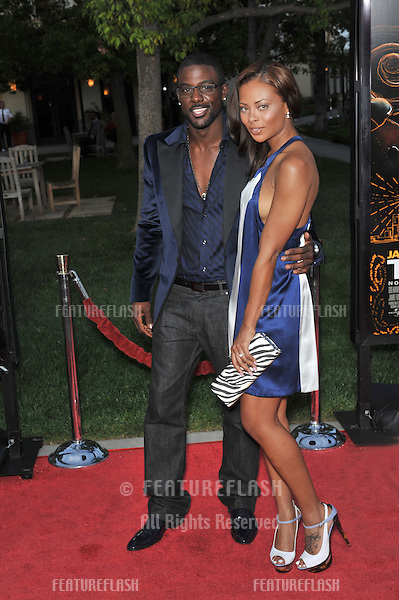 Eva Pigford & fiancé Lance Gross at the Los Angeles premiere of The Soloist at Paramount Theatre, Hollywood. .April 20, 2009  Los Angeles, CA.Picture: Paul Smith / Featureflash