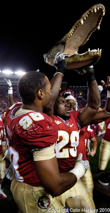 TALLAHASSEE, FL 11/27/10-FSU-UF FB10 CH-Florida State's Marcus White, left, and Kendall Smith celebrate their victory over Florida Saturday at Doak Campbell Stadium in Tallahassee. The Seminoles beat the Gators 31-7..COLIN HACKLEY PHOTO