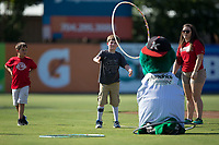 A young fan attempts to toss a hula-hoop around Kannapolis Intimidators mascot Tim E. Gator between innings of the game against the Delmarva Shorebirds at Kannapolis Intimidators Stadium on July 2, 2017 in Kannapolis, North Carolina.  The Shorebirds defeated the Intimidators 5-4.  (Brian Westerholt/Four Seam Images)